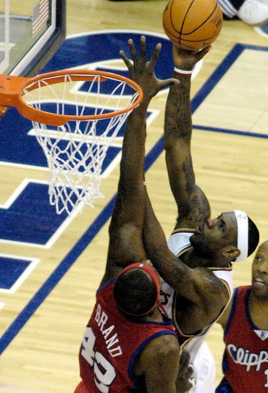 . Michael Blair@News-Herald.com The Cavs\' LeBron James is fouled by the Clippers Elton Brand during the second quarter of Wednesday\'s game at Quicken loans Arena.