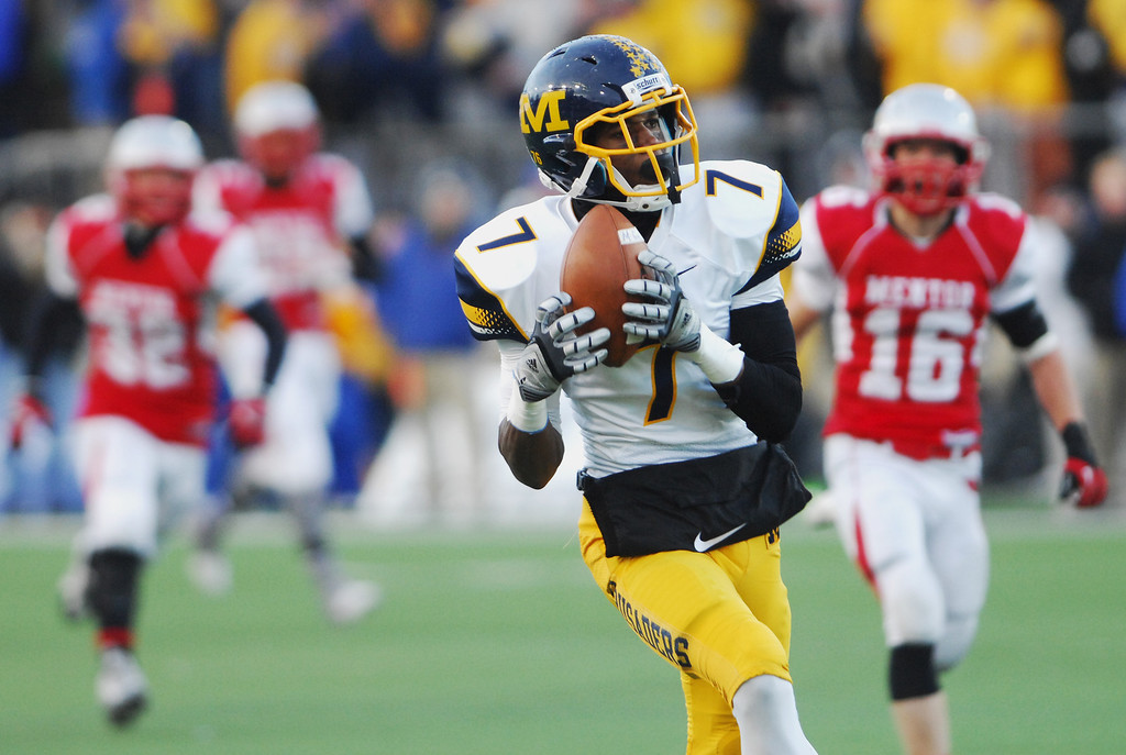. Michael Allen Blair/ MBlair@News-Herald.com Cincinnati Moeller wide receiver Isaiah Gentry catches a long pass near the goal line behind Mentor defensive back Austin (16) Hankins during Saturday\'s Div. I state championship game at Fawcett Stadium in Canton.