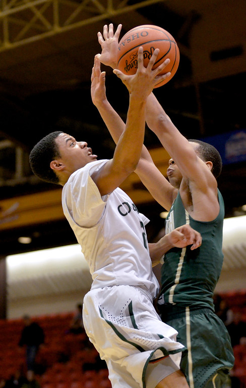 . Jeff Forman/JForman@News-Herald.com Justin Robinson shoots in the fourth quarter of Lake Catholic\'s 68-52 Division II regional semifinal loss March 13 to St. Vincent St. Mary at the Canton Civic Center.