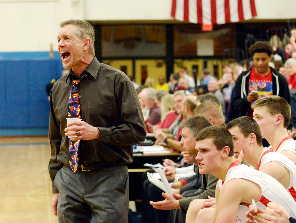 . Maribeth Joeright/MJoeright@News-Herald.com<p> Mentor boys basketball coach Bob Krizancic communicates concerns to his team during the Division I district semifinal game against Glenville.