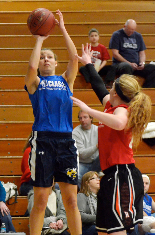 . Jeff Forman/JForman@News-Herald.com Karen Somes, Blue, shoots as Halle McKinley defends during the 36th News-Herald Classic March 29 at Lakeland Community College.