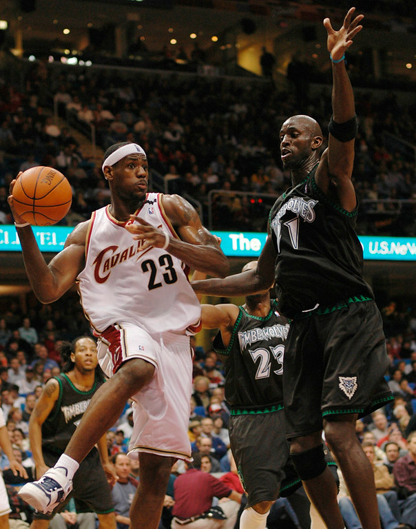. Michael Blair/News-Herald The Cavs Lebron James looks for an open man under the basket as the Timber Wolves\' Kevin Garnett defends durinng the second half of Tuesday night\'s game at Gund Arena.