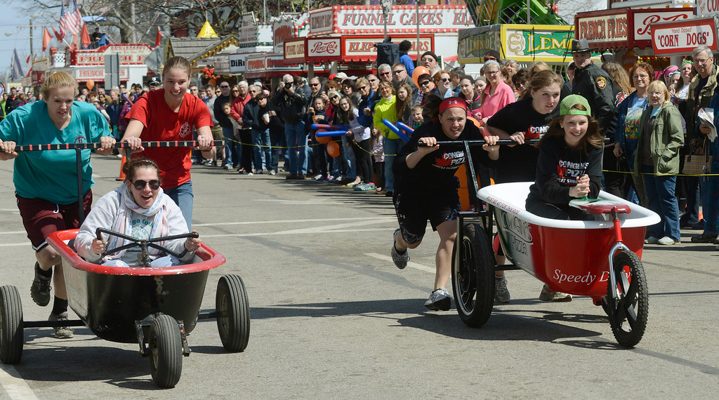 . Maribeth Joeright/MJoeright@News-Herald.com The bathtub race team, Breeders and Feeders, left, and Congin\'s Pizza run a close race with Breeders and Feeders winning first place by a hair during the 85th annual Geauga County Maple Festival.