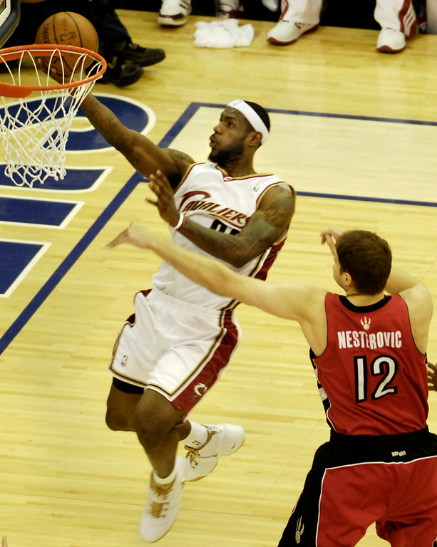 . Michael Blair/MBlair@News-Herald.com The Cavs LeBron James scores his third basket Friday night past the Raptors\' Rasho Nesterovich during the first quarter of Friday\'s game at the Quicken Loans Arena. The basket made James the Cavs\' alltime leading scorer in team history.