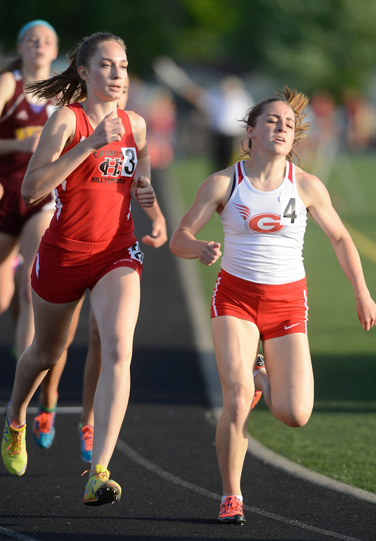 . Maribeth Joeright/MJoeright@News-Herald.com<p> Chardon\'s Rachel Banks and Geneva\'s Emily Deering run a close race in the girls 800 meter run during the Division I regional final track and field championhips at Austintown Fitch High School, May 30 2014. Banks took first place.