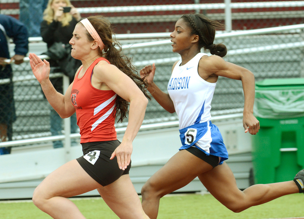 . Maribeth Joeright/MJoeright@News-Herald.com<p> Chardon\'s Stephanie Ferrante passes Madison\'s Chanel Crawford in time to win the girls 100 meter dash during the PAC meet in Geneva.