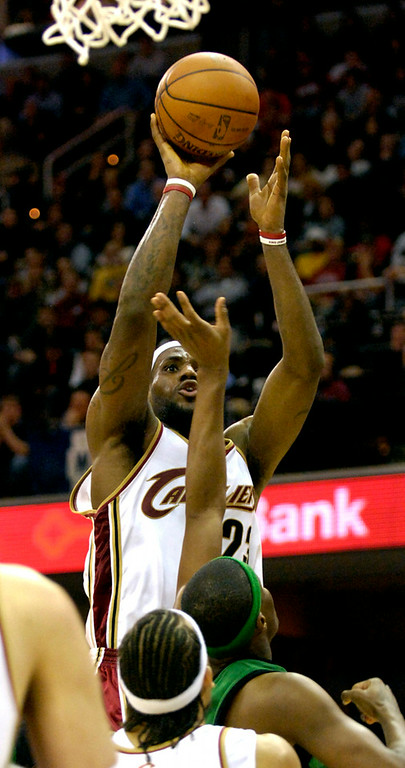 . Jeff Forman/JForman@News-Herald.com LeBron James shoots over Paul Pierce, Boston, to score two points late in the fourth quarter of the Cavaliers 114-113 win over the Celtics Tuesday at Quicken Loans Arena.