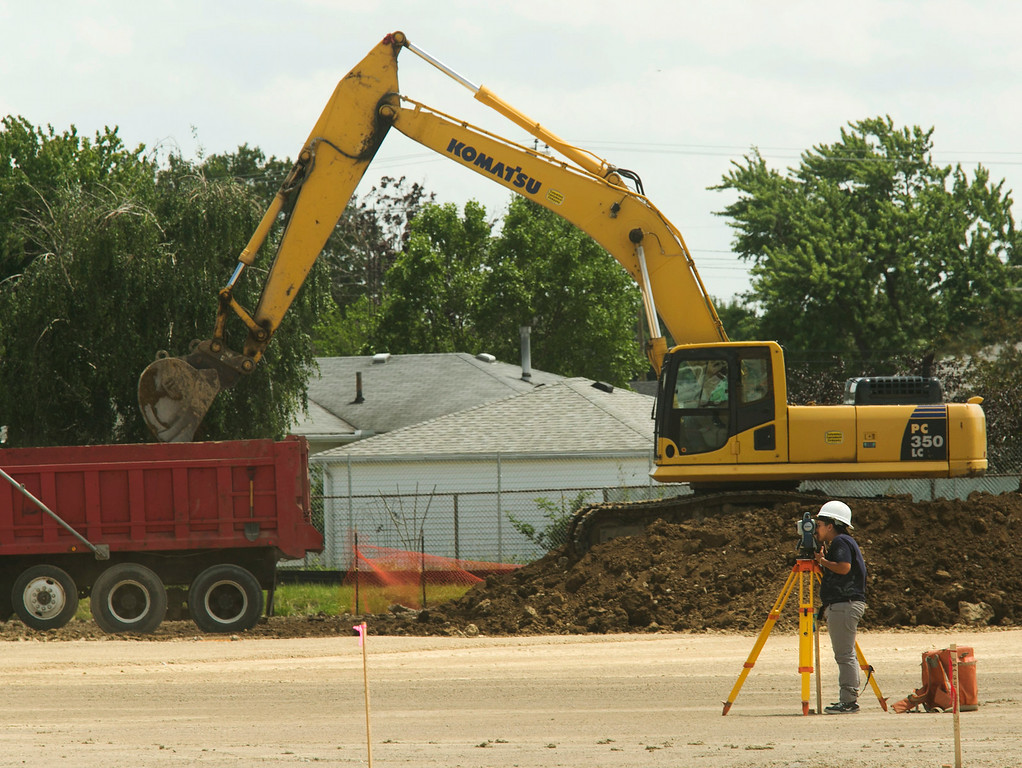 . Michael Allen Blair/MBlair@MorningJournal.com A surveyer charts the terrain of the new Lorain Admiral King High School in Lorain on June 30.