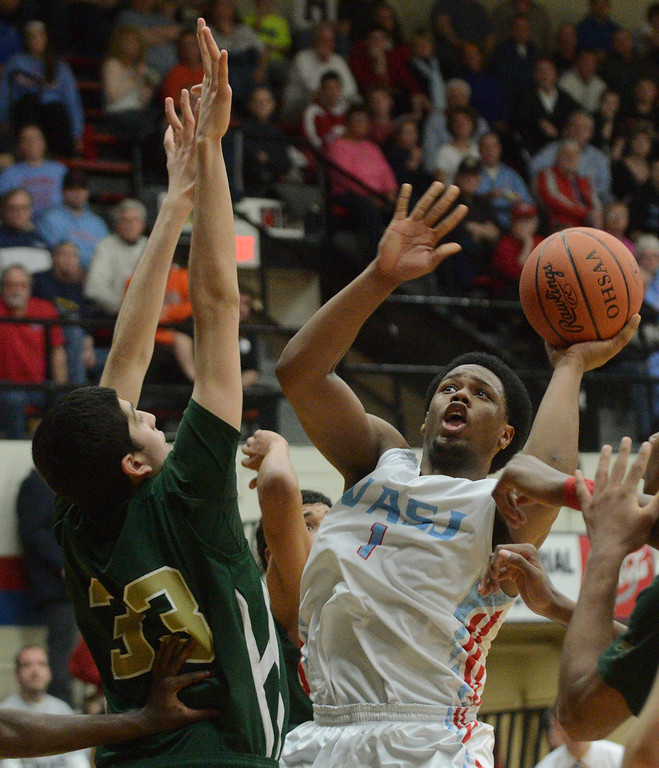 . Duncan Scott/DScott@News-Herald.com VASJ\'s Brian Parker goes up for a shot in the third quarter defended by Ursuline\'s Armon Nasseri. VASJ defeated Youngstown Ursuline 69-60 March 15 in the Division III regional final at Canton Memorial Fieldhouse.