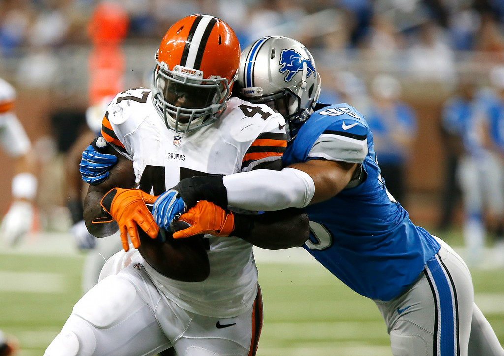 . Detroit Lions outside linebacker Kyle Van Noy (95) knocks the ball from Cleveland Browns\' MarQueis Gray (47) in the first half of a preseason NFL football game at Ford Field in Detroit, Saturday, Aug. 9, 2014. The play was ruled an incomplete pass. (AP Photo/Duane Burleson)