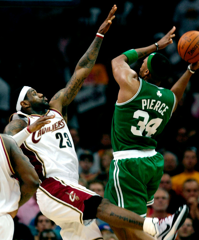 . Jeff Forman/JForman@News-Herald.com LeBron James tries to block Paul Pierce in the second half of game one of the eastern conference semifinal game Saturday at Quicken Loans Arena.
