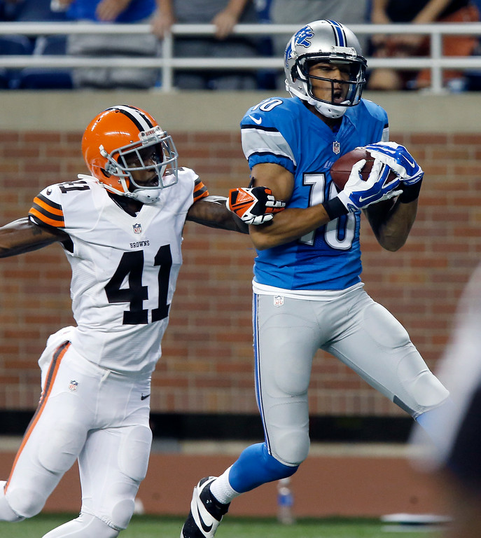 . Detroit Lions wide receiver Corey Fuller (10) catches a 21 yard touchdown pass against Cleveland Browns defensive back T.J. Heath (41) to tie the game at 12-12 during the fourth quarter of a preseason NFL football game against the Detroit Lions at Ford Field Saturday, Aug. 9, 2014, in Detroit. The Lions defeated the Browns 13-12. (AP Photo/Duane Burleson)
