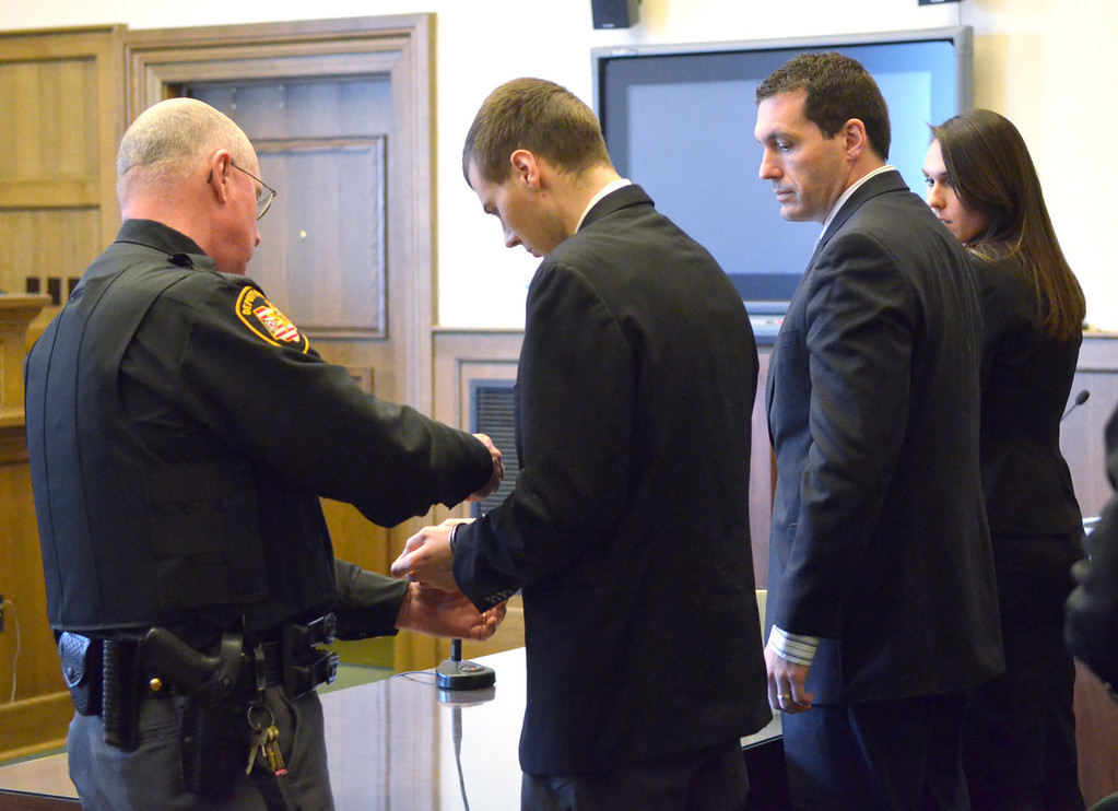 . Jeff Forman/JForman@News-Herald.com Nathaniel Brown\'s lawyers watch as Brown is handcuffed after being convicted Feb. 21 on two of 11 counts in the 2011 killing of William Andrew Fayne Putzbach.