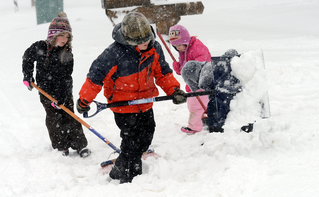 . Maribeth Joeright/MJoeright@News-Herald.com Dominic Pandolfi, 7, and friends Emma Fitzpatrick, 7, left, and her sister Chloe, 4, help shovel the driveway of the Galon family, Wednesday, on Weatherby Drive in Mentor. Mentor students are enjoying another snow day.