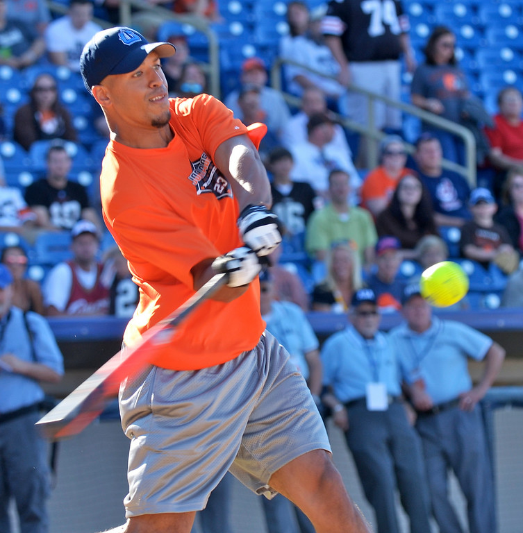 . Jeff Forman/JForman@News-Herald.com Miles Austin connects during the Joe Haden and Friends Softball Game home run derby July 17 at Classic Park.