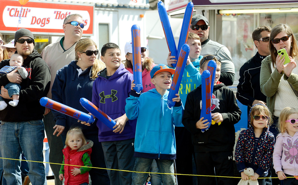 . Maribeth Joeright/MJoeright@News-Herald.com<p> On the sidelines, children and adults alike cheer on the competitors during the bathtub races at the 85th annual Geauga County Maple Festival, April 27, 2014.