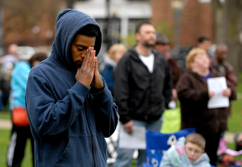 . Jeff Forman/JForman@News-Herald.com Ernest Ruffin, of Cleveland, prays during a National Day of Prayer observance May 1 in Painesville.