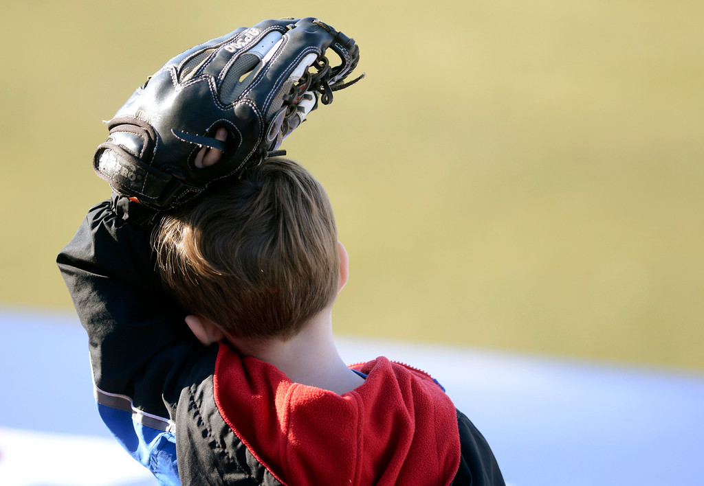. Maribeth Joeright/MJoeright@News-Herald.com<p> A little Captains fan hopes to catch a foul ball during an exhibtion game against the Rubberducks.
