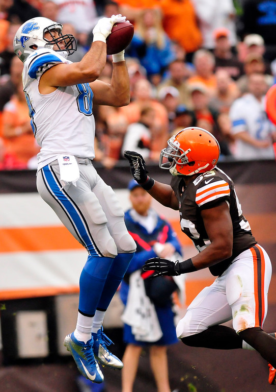 . Sam Greene/The Morning Journal Lions wide receiver Joseph Fauria (80) makes a leaping catch in the end zone over Browns linebacker Craigh Robertson (53) for a touchdown late in the fourth quarter of the NFL week six game between the Cleveland Browns and Detroit Lions at FirstEnergy Stadium in Cleveland, Ohio, on Sunday, Oct. 13, 2013. Fauria made 3 of Detroit\'s 4 touchdown catches in the 31-17 Lions victory.