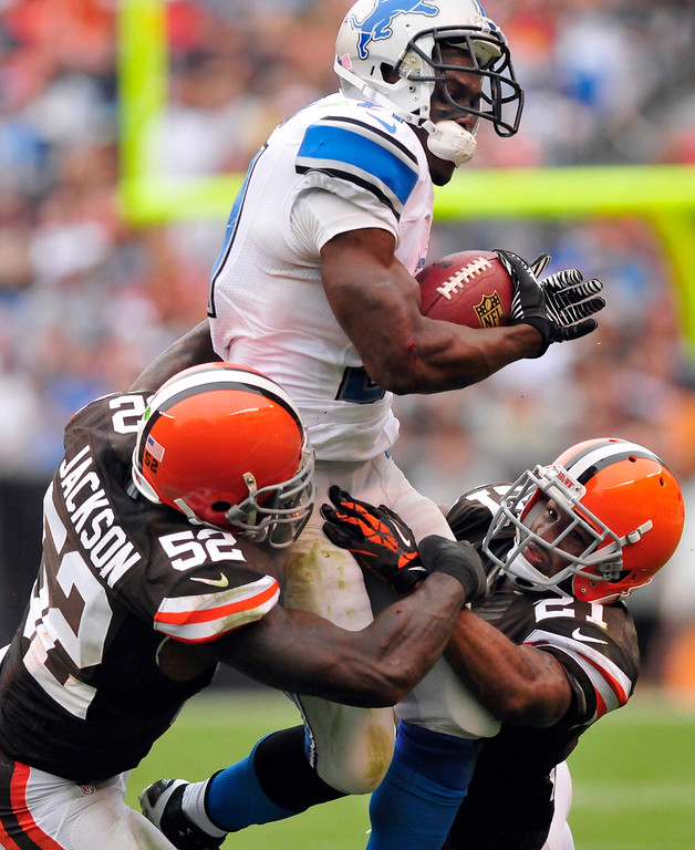 . Sam Greene/The Morning Journal Lions running back Reggie Bush (21) leaps into a tackle by Browns linebacker D\'Qwell Jackson (52) and defensive back Chris Owens (21) during the fourth quarter of the NFL week six game between the Cleveland Browns and Detroit Lions at FirstEnergy Stadium in Cleveland, Ohio, on Sunday, Oct. 13, 2013. Bush led the Lions offense with 78 rushing yards on 17 carries against the Browns.