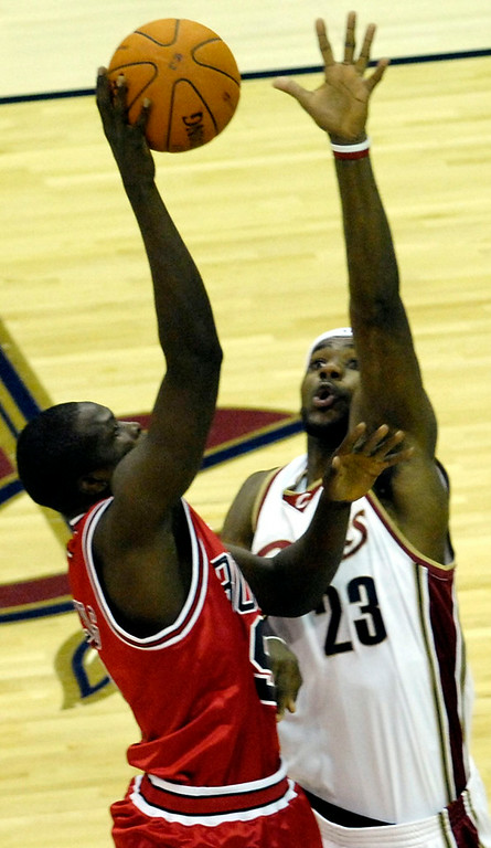 . Michael Blair/MBlair@News-Herald.com The Cavs\' LeBron James tries to block a pass by the Bulls Luol Deng during the second period of Thursday night\'s game at Quicken Loans Arena.