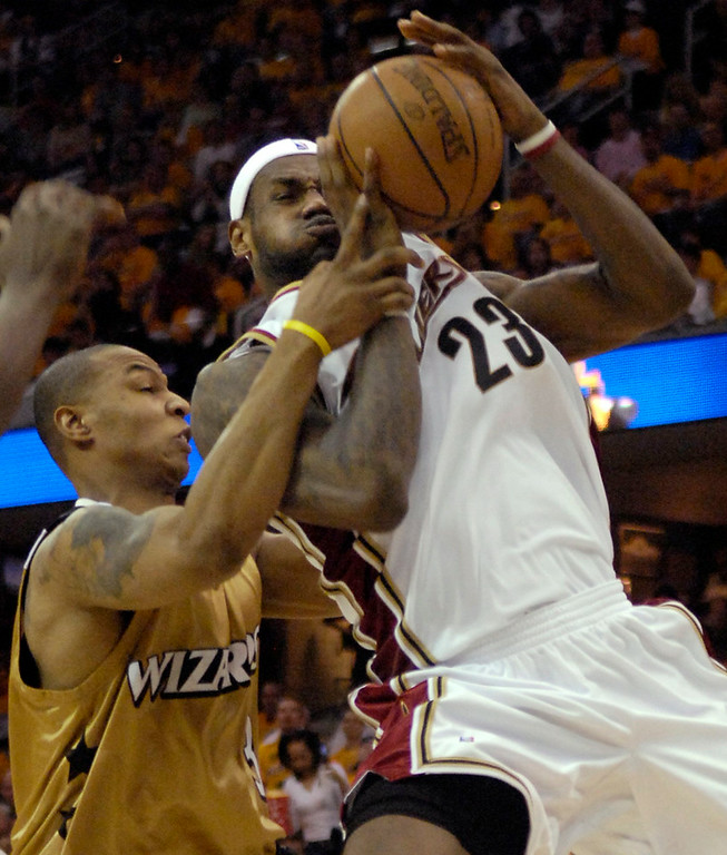 . Michael Blair/MBlair@News-Herald.com The Cavs LeBron James is fouled in the lane by the Wizards\' Caron Butler during the third quarter of Saturday\'s game at The Q.