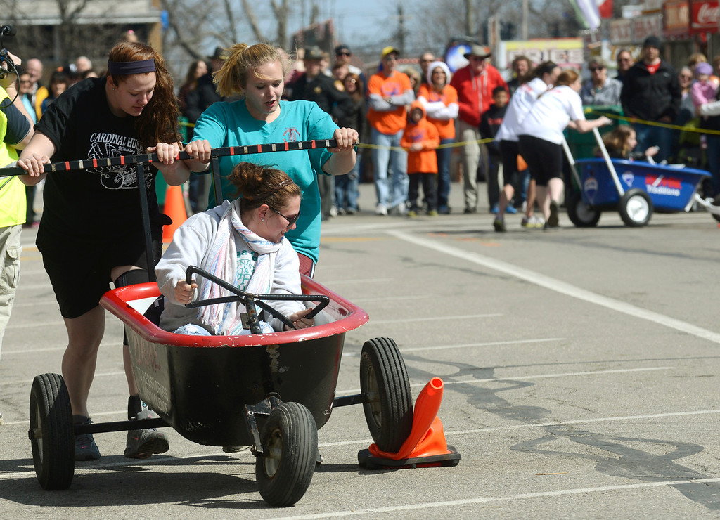 . Maribeth Joeright/MJoeright@News-Herald.com<p> Members of the 4-H team Breeders and Feeders, struggle to get around the cone during the popular bathtub race event at the 85th annual Geauga County Maple Festival. Shown are, Kelsey Zimperman, driving, Katie Pitovak, left, and Tracey Teichman.