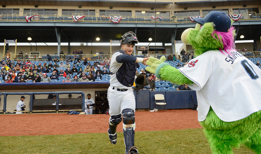 . Maribeth Joeright/MJoeright@News-Herald.com<p> Lake County Captains catcher Eric Haase high-fives Skipper as he takes the field prior to the start of the team\'s home opener against Lansing, April 4, 2014.