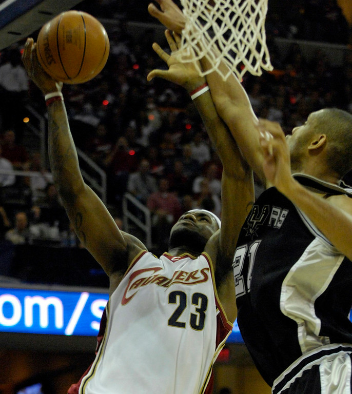 . Spurs forward Tim Duncan attempts to block a shot by Lebron James in the first quarter of Game 4 of the NBA finals.