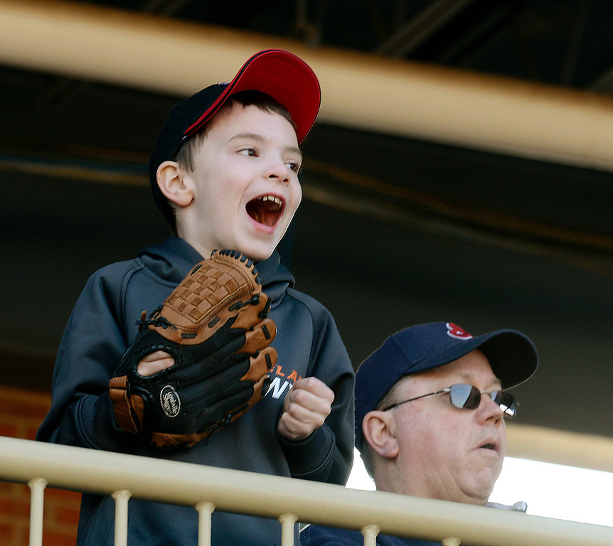 . Maribeth Joeright/MJoeright@News-Herald.com<p> Zach Koenig, 6, cheers on the Lake County Captains during an exhibition game against Akron.