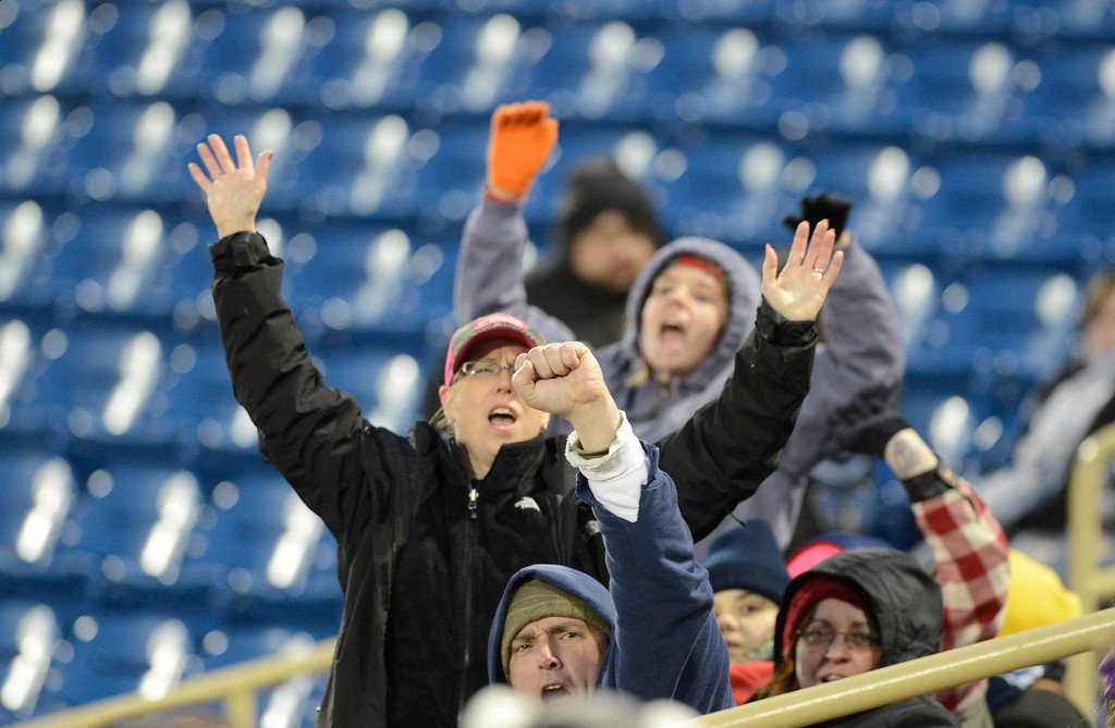 . Maribeth Joeright/MJoeright@News-Herald.com<p> Chilly temperatures, wind and rain, plus a disappointing performance by the Captains, didn\'t keep the spirits of these fans down during the home opener at Classic Park, April 4, 2014.