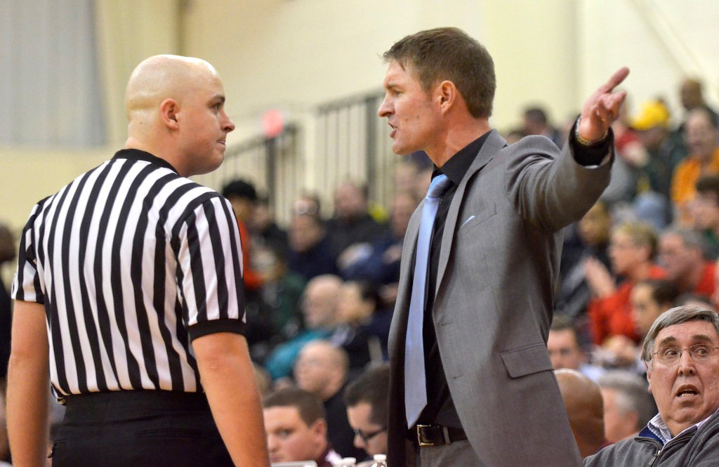 . Jeff Forman/JForman@News-Herald.com Vikings coach Babe Kwasniak argues a call during VASJ\'s 82-71 win over Mentor Sunday in the Dunk4Diabetes Shootout at Walsh University in North Canton.