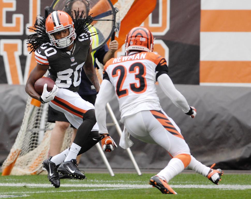 . Jeff Forman/JForman@News-Herald.com Browns wide receiver Travis Benjamin sets up a first quarter touchdown against the Cincinnati Bengals Sunday at FirstEnergy Stadium.
