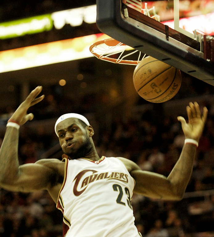 . Michael Blair/MBlair@News-Herald.com LeBron James slams home two poits during the third quarter of Friday\'s game versus the raptors at the Quicken Loans Arena.