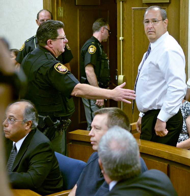 . Jeff Forman/JForman@News-Herald.com Nicholas Zanella, Lisa Knoefel\'s first husband, is removed from the courtroom after uttering an obscenity during Kevin Knoefel\'s sentencing Aug. 6 in Lake County Common Pleas Court.