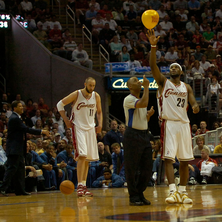 . PHOTO BY DAVID RICHARD LeBron James of Cleveland gives a taller hand to NBA official Marc Davis after the ref failed to reach a balloon floating over the court at Quicken Loans Arena