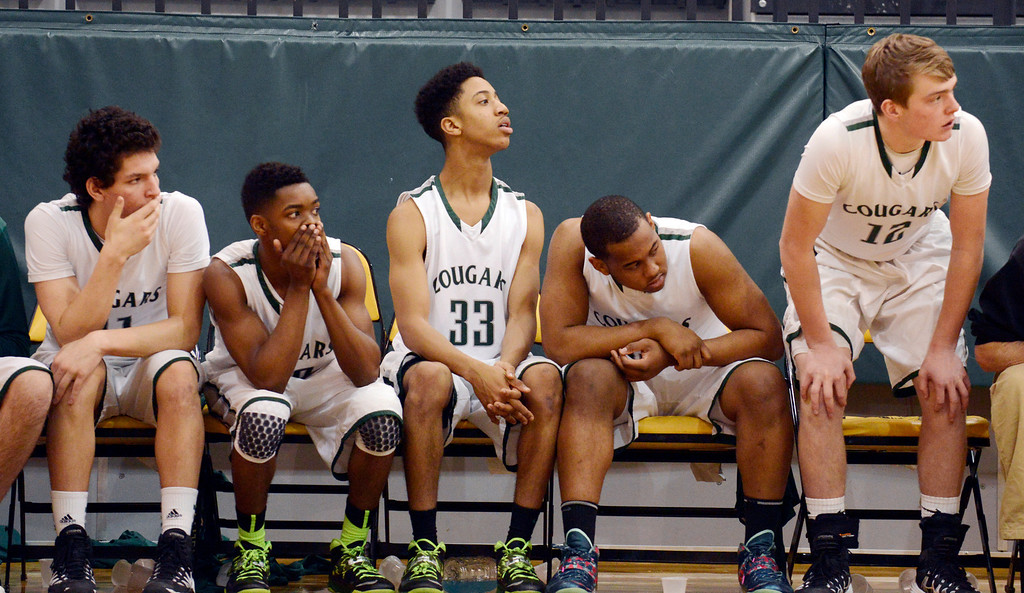 . Maribeth Joeright/MJoeright@News-Herald.com Members of the Lake Catholic basketball team watch as Chagrin Falls attempts a late game rally during the Division II district final game, March 8, 2014. Lake Catholic held on to the lead and won the game 68-59.