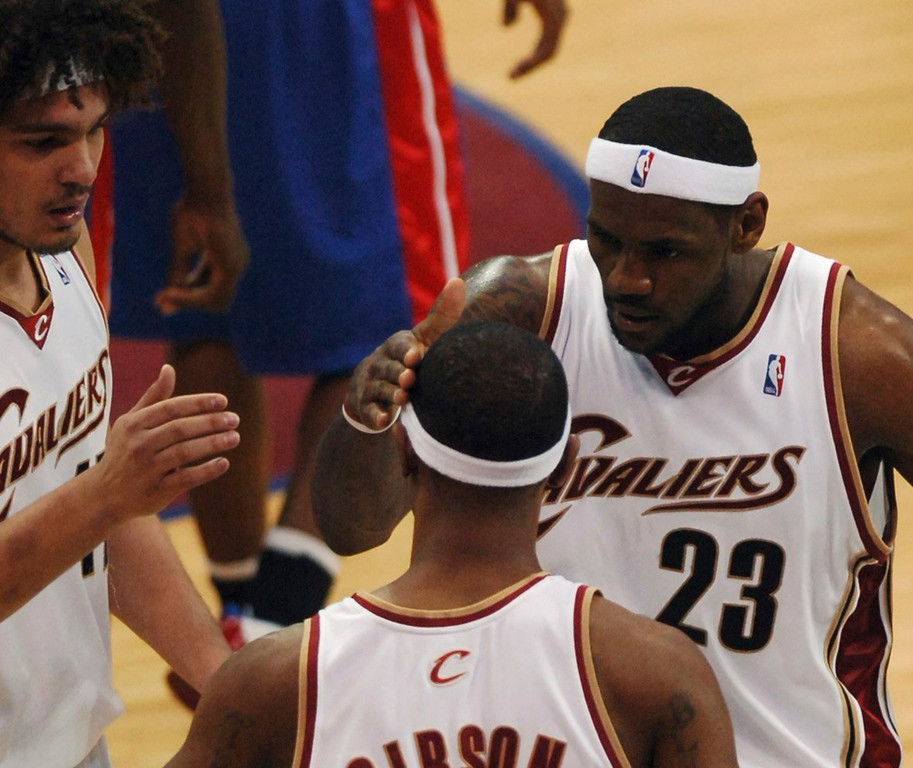 . MORNING JOURNAL/DAVID RICHARD Daniel Gibson is congratulated by Anderson Varejao and LeBron James after he was fouled on a 3-point attempt last night.