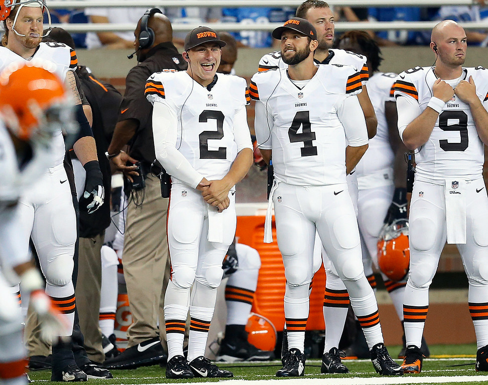 . Cleveland Browns quarterbacks Johnny Manziel (2) and Tyler Thigpen (4) stand on the sideline against the Detroit Lions in the first half of a preseason NFL football game at Ford Field in Detroit, Saturday, Aug. 9, 2014. (AP Photo/Rick Osentoski)