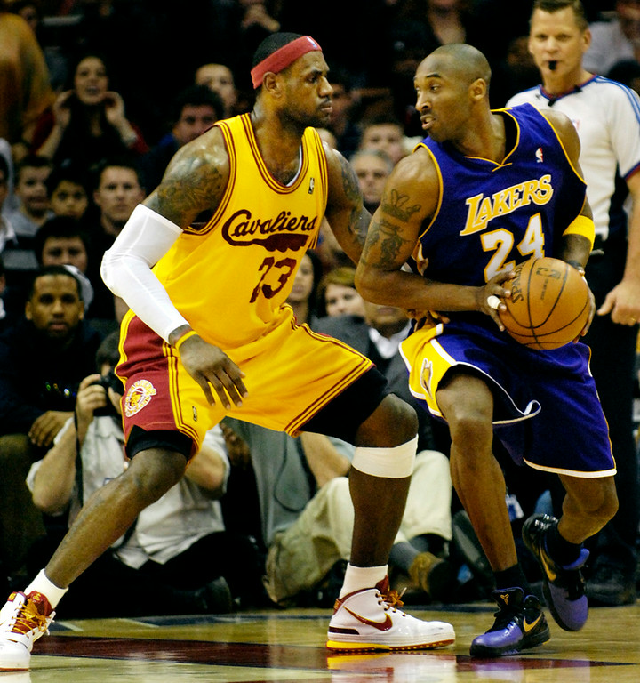 . Jeff Forman/JForman@News-Herald.com LeBron James guards Kobe Bryant in the fourth quarter of the Cavaliers\' loss to Lakers Sunday at Quicken Loans Arena.