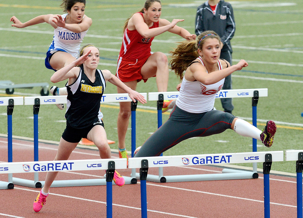 . Maribeth Joeright/MJoeright@News-Herald.com<p> Geneva\'s Ally Thompson takes the lead and easily wins the girls 100 meter hurdles during the PAC meet at SPIRE Institute, May 15, 2014. It was a good day for Thompson who also won the girls pole vault.