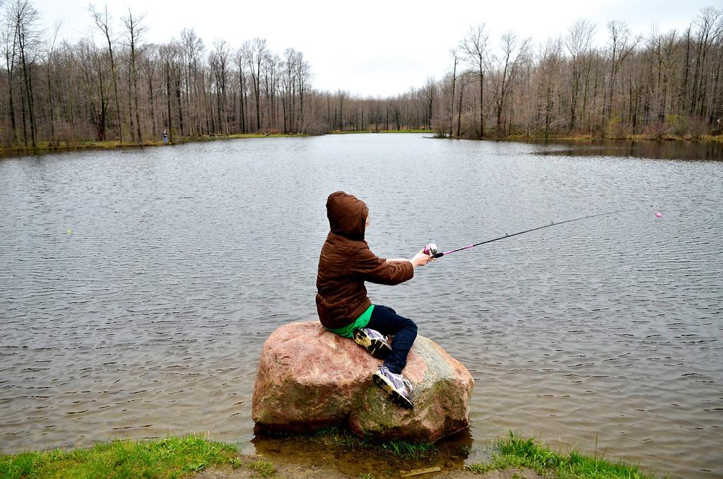 . Jeff Forman/JForman@News-Herald.com Junior volunteer Julie Chamileski, 9, casts her line during the Lake Metroparks Fantastic Fishing program for people with disabilities April 30 at Hidden Lake in Leroy Township.
