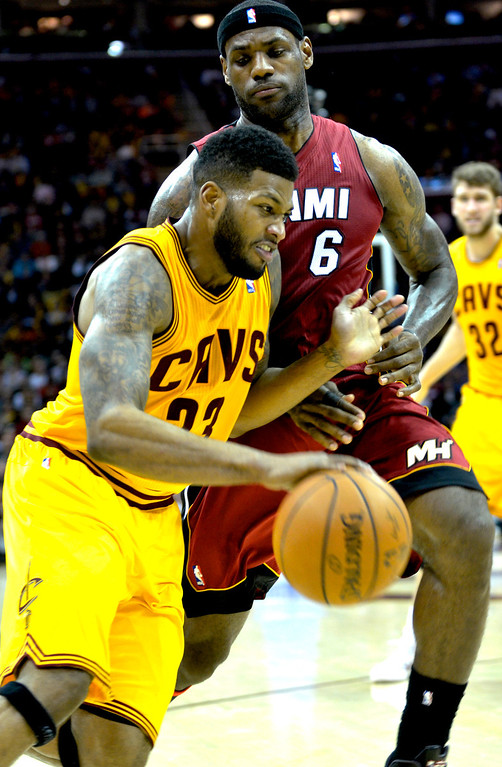 . Jeff Forman/JForman@News-Herald.com Alonzo Gee drives against LeBron James during the Cavaliers\' 100-96 loss to the Heat March 18 at Quicken Loans Arena.